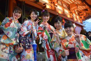 five women wearing oriental dresses